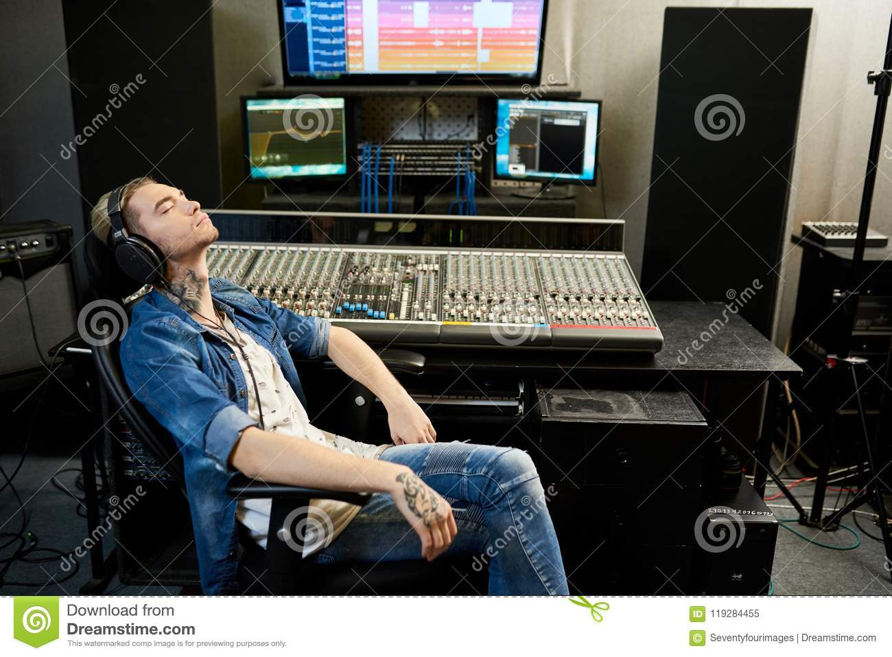 Man listening to music in studio