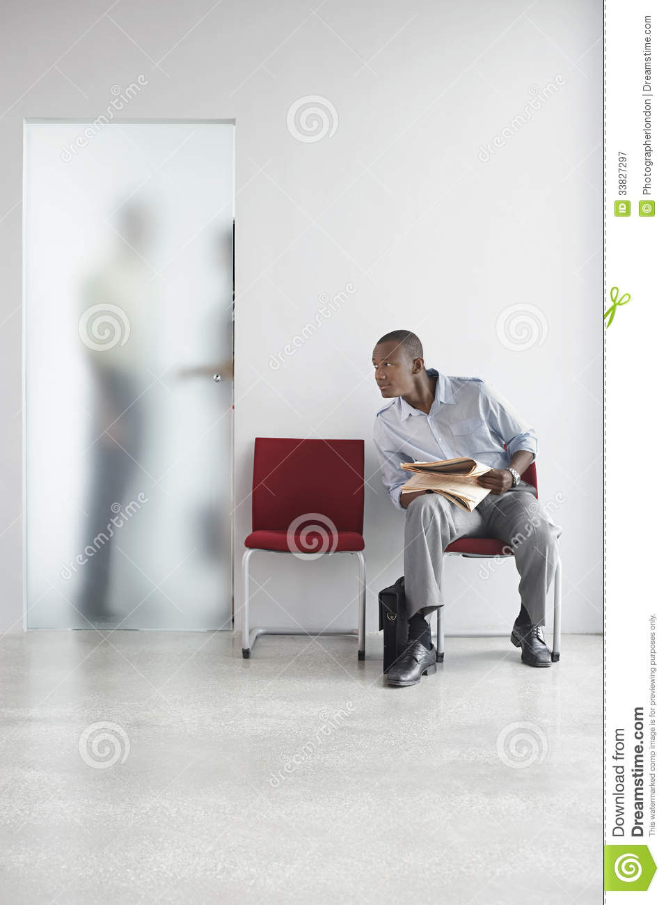 Man Listening To People Talk Behind Translucent Door