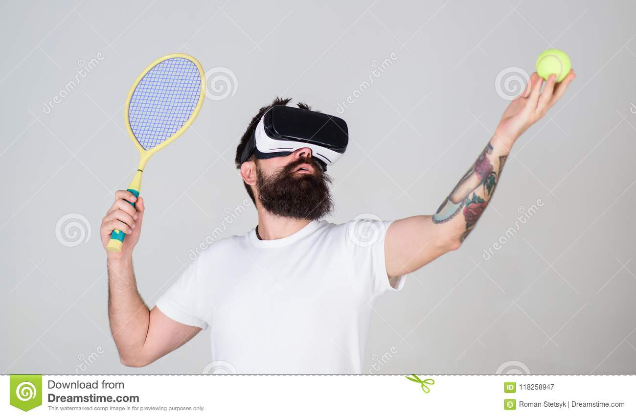 Man With Long Beard Holding Tennis Ball And Bat Isolated On Gray