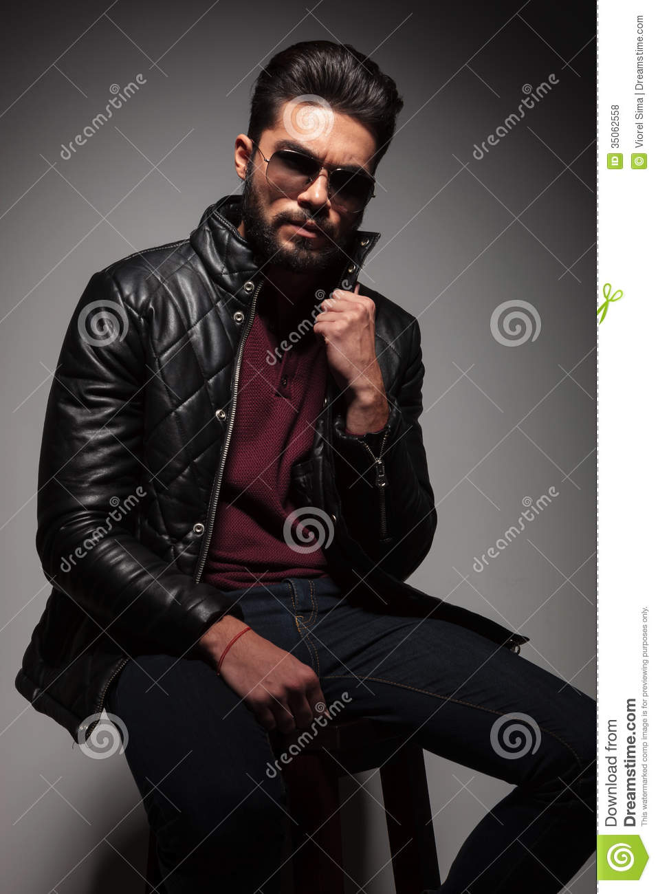 Man With Long Beard Is Pulling His Leather Jacket S Collar