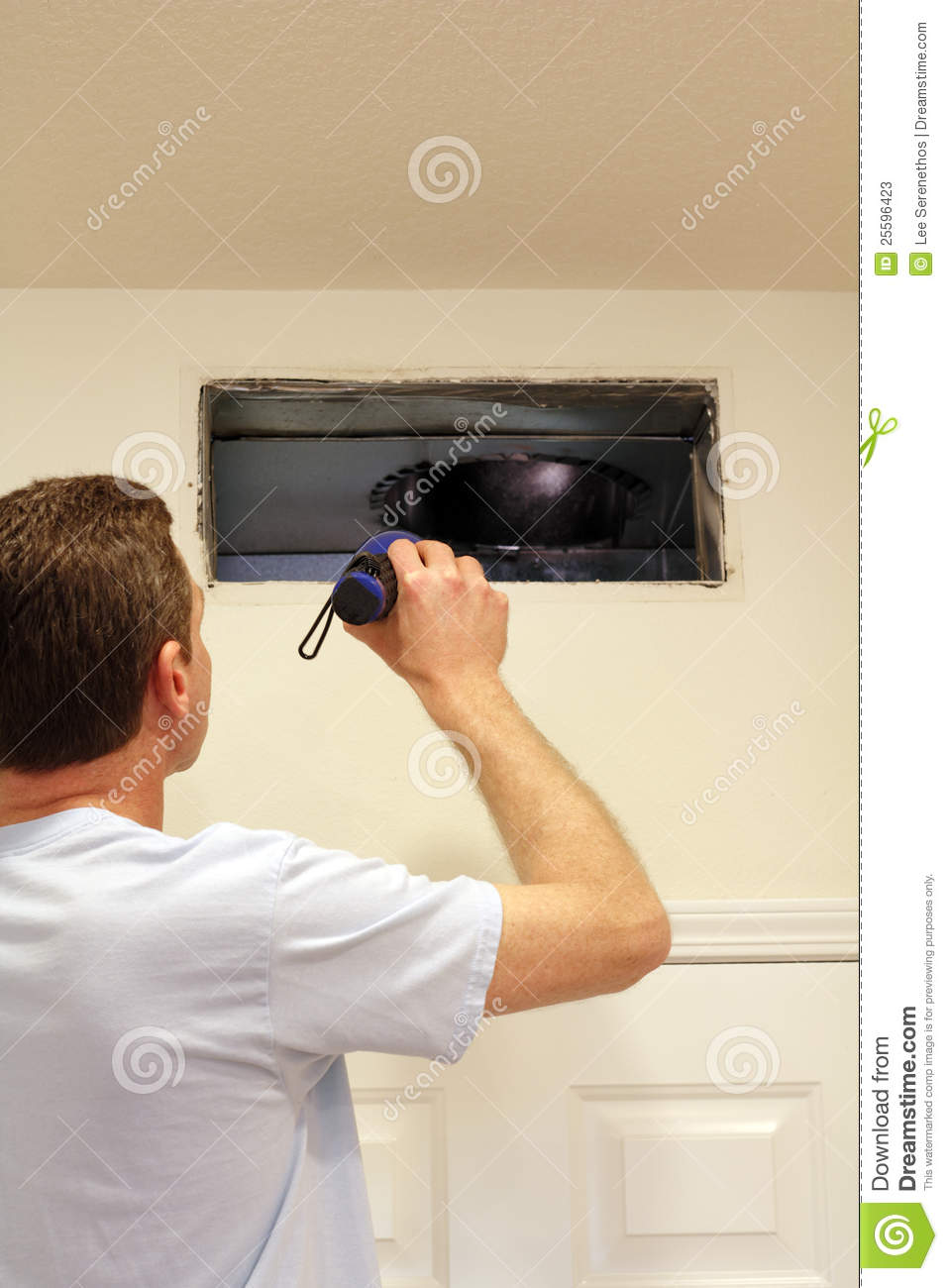 Man Looking into Air Duct