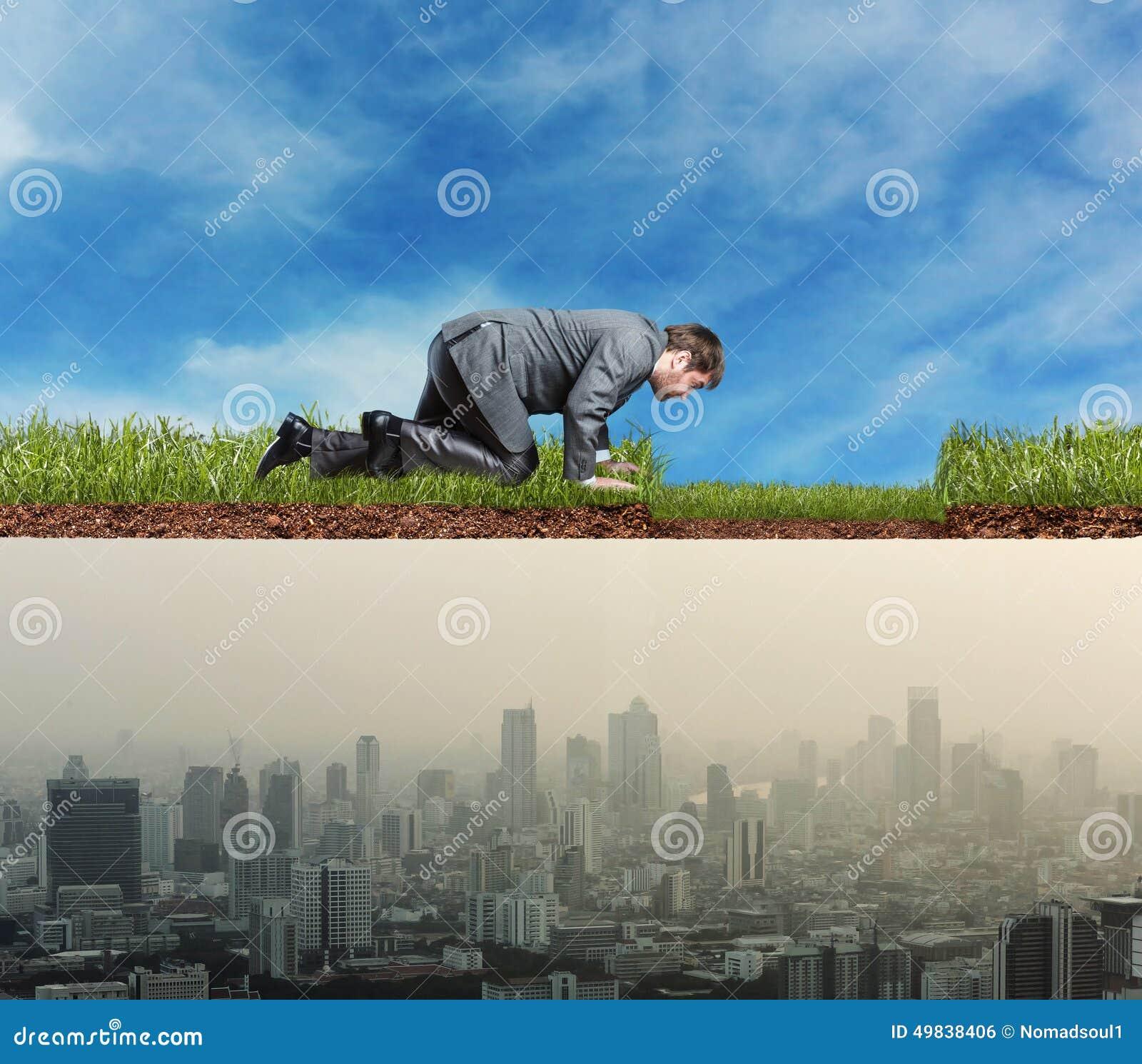 Man looking at big city side