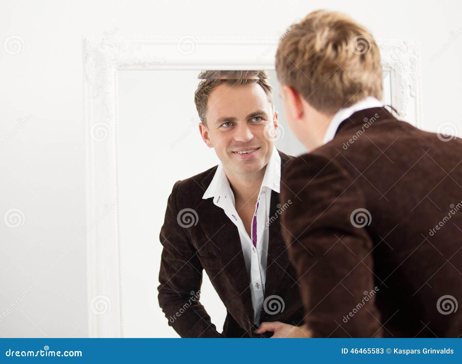 man looking at himself in mirror stock photo 46465583 megapixl