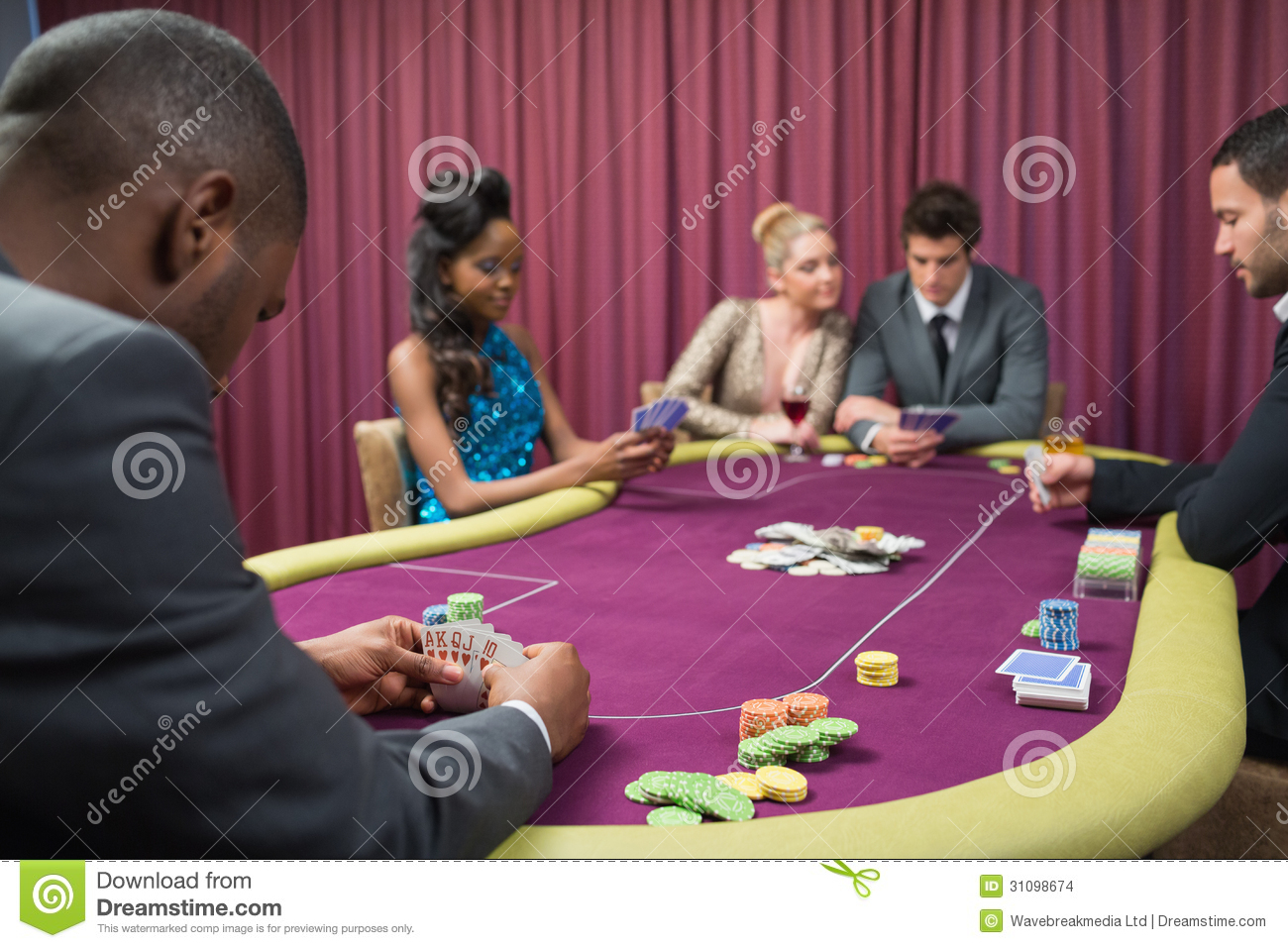 Locking person looking at their cards in poker Capital Empires play free slots