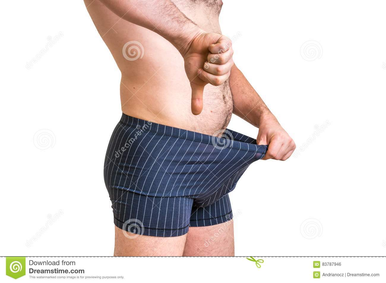 Man is looking in his underwear and pointing thumb down
