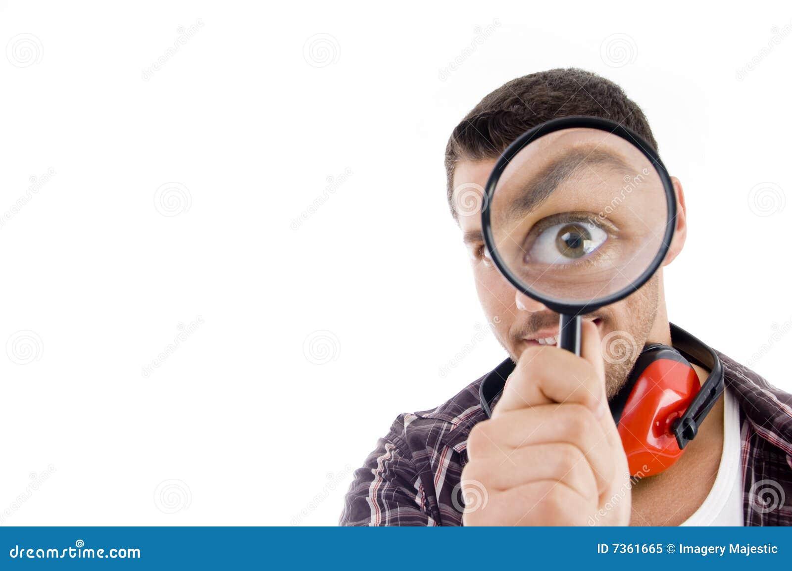 Man Looking Through Magnifying Glass Royalty Free Stock