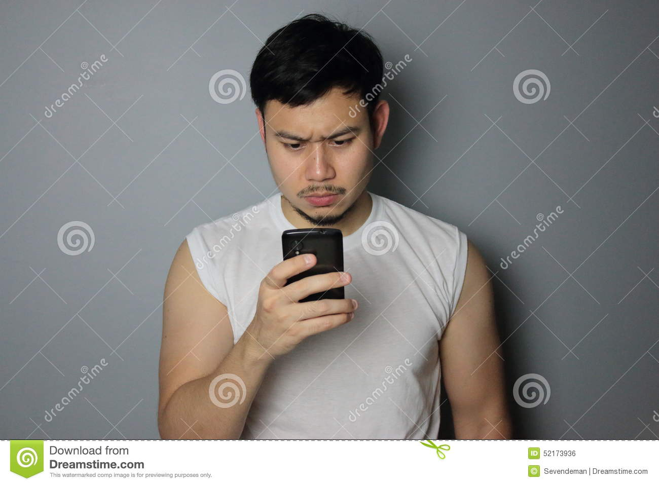 A man is looking on the mobile phone.