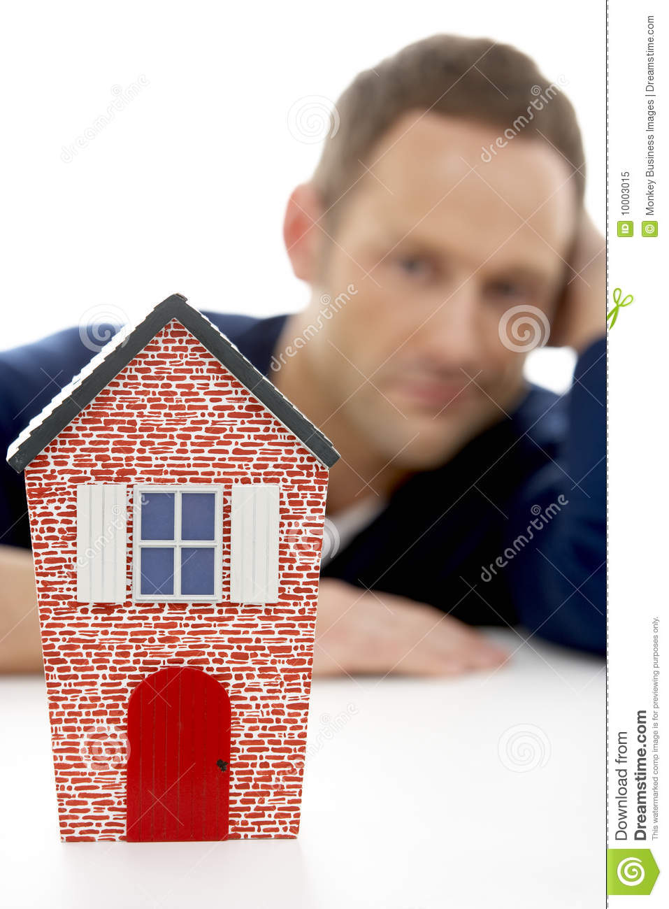 Man Looking At Model House