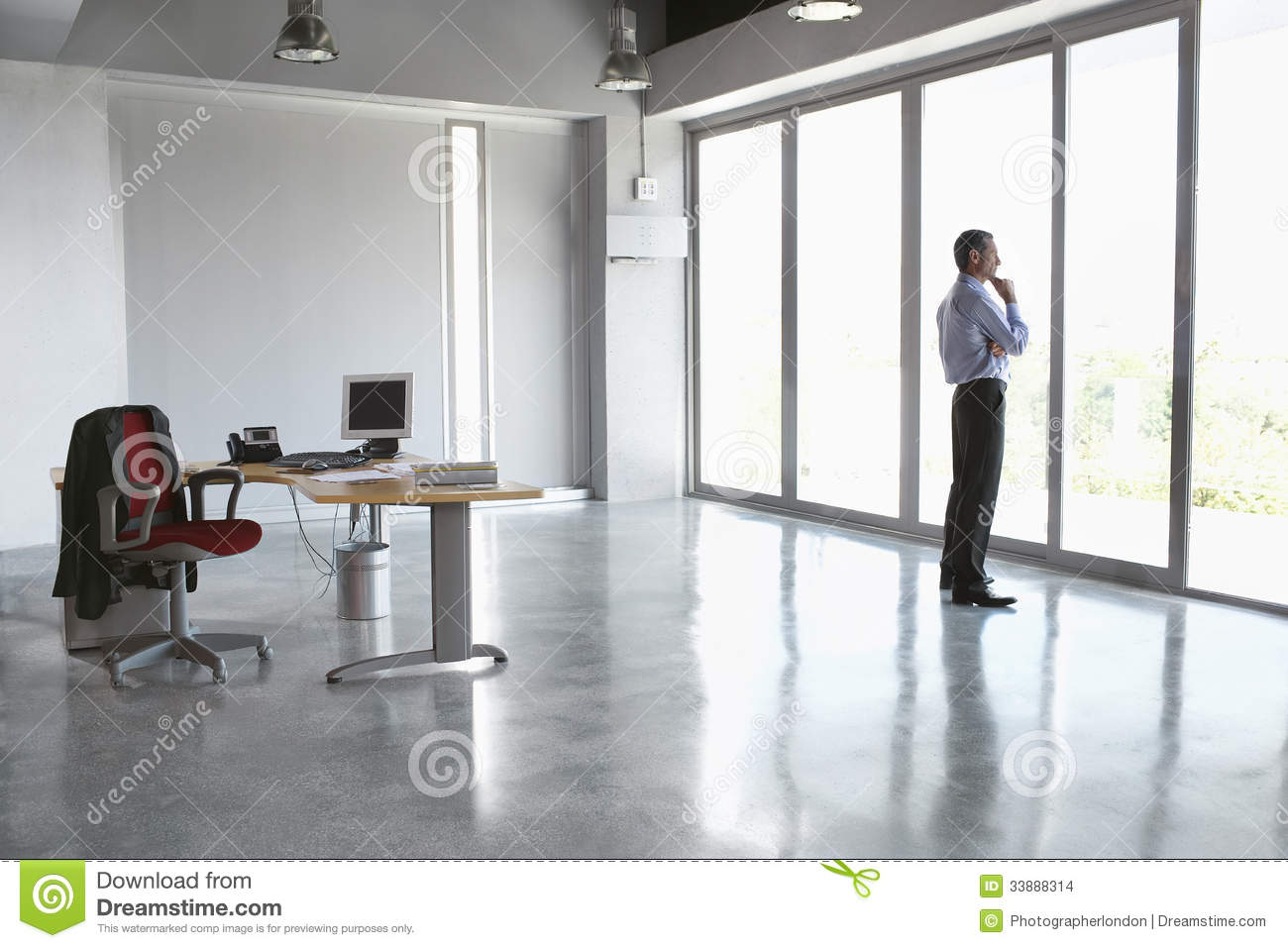 Man Looking Out Of Glass Door In Empty Office Stock Photo Image Of