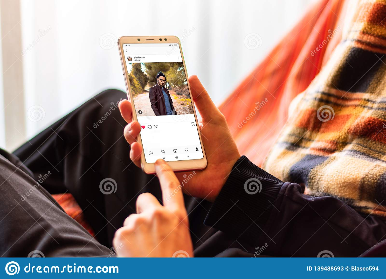Man looking at photo sharing app on mobile phone