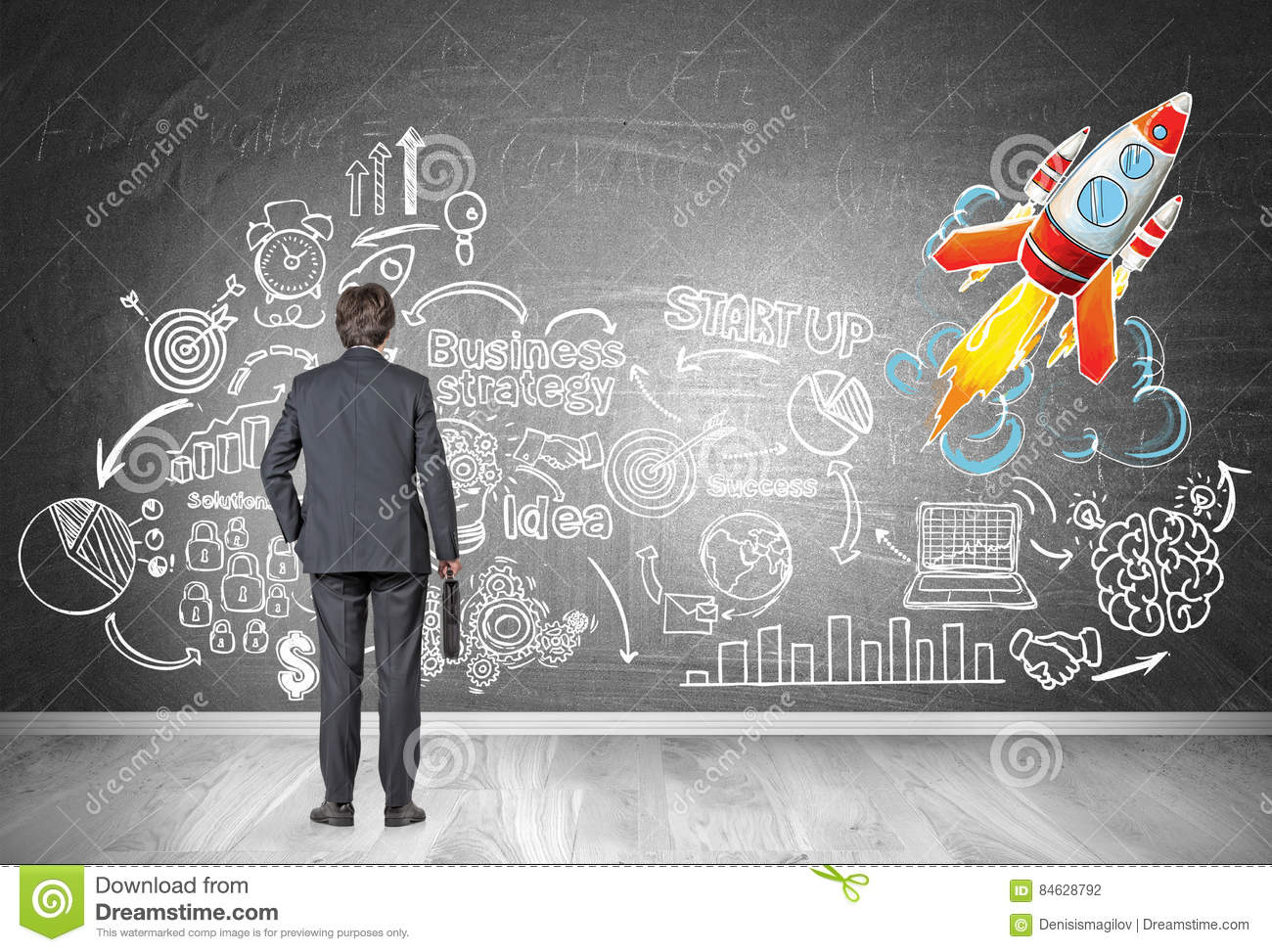 Man Looking At Start Up Sketch And Rocket Stock Photo