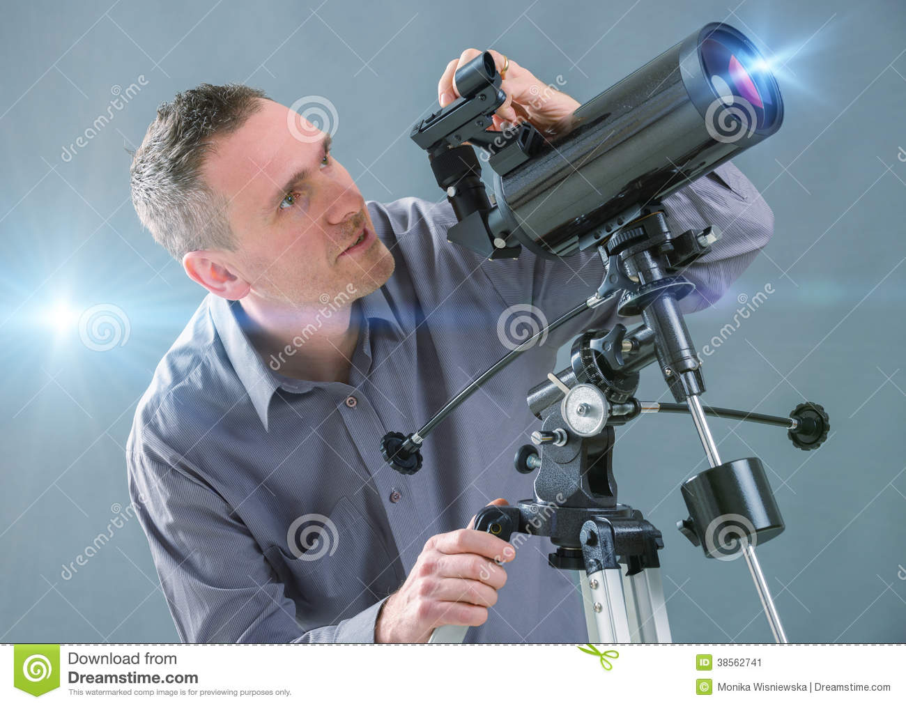 Man Looking Through Telescope Stock Image - Image: 38562741