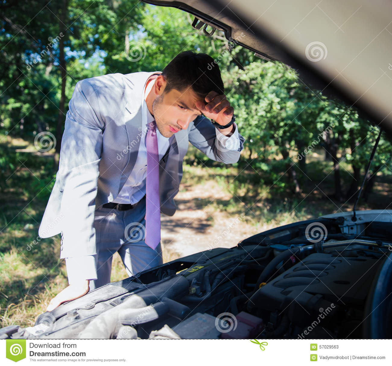 Man Looking Under The Hood Of Car Stock Image