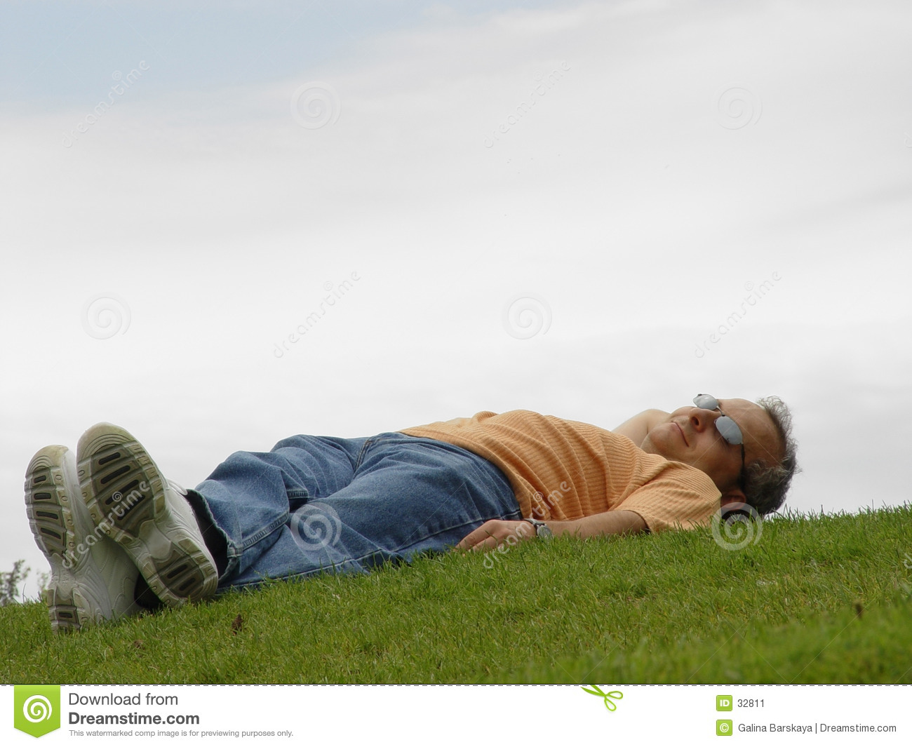 A man lying on the grass