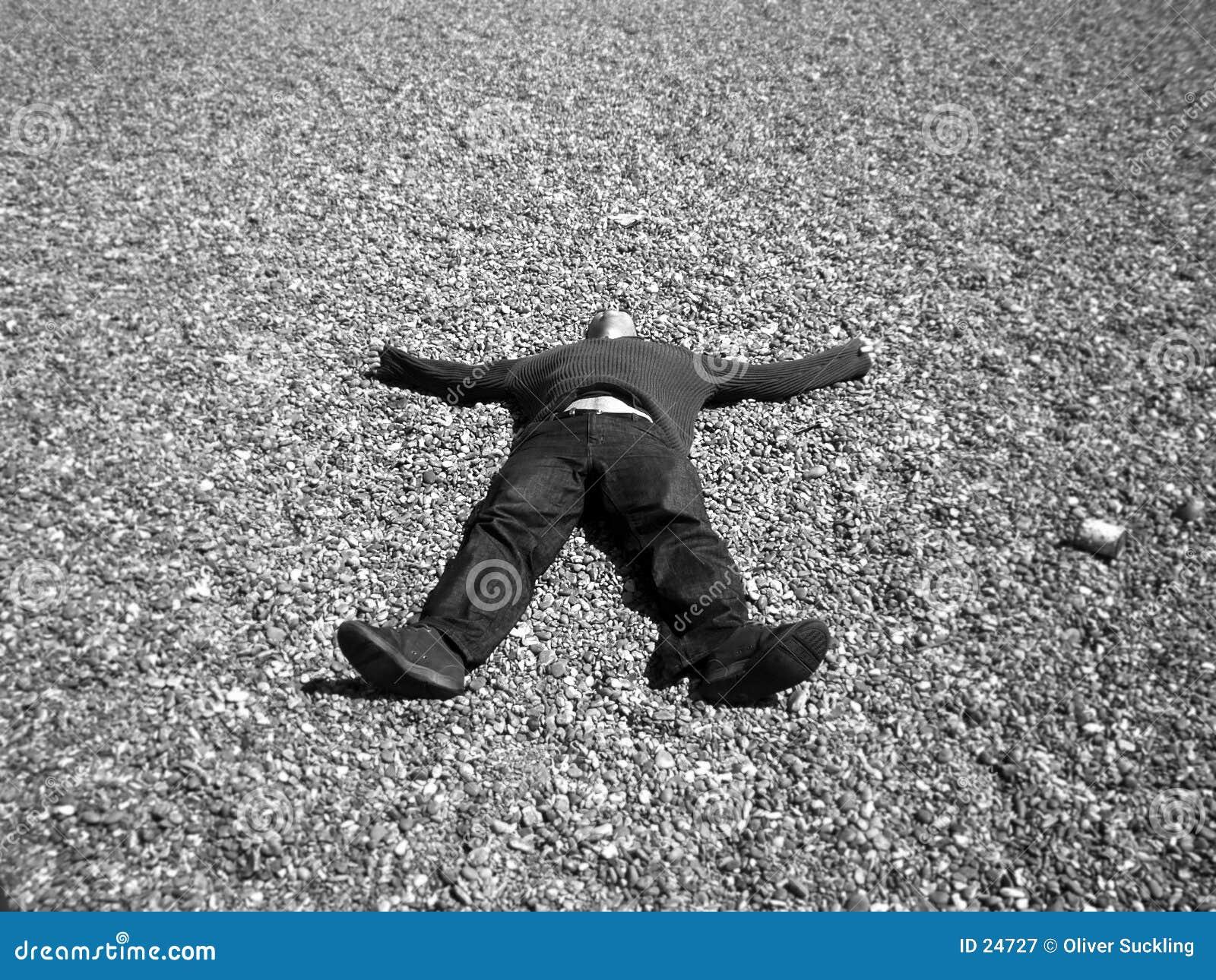 A man lying on stones