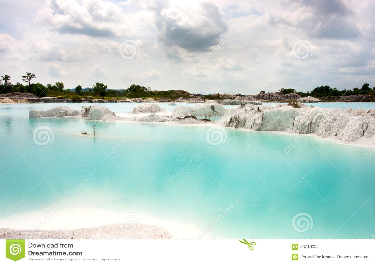 Man-made artificial clear blue lake Kaolin, mining ground holes covered by rain water.