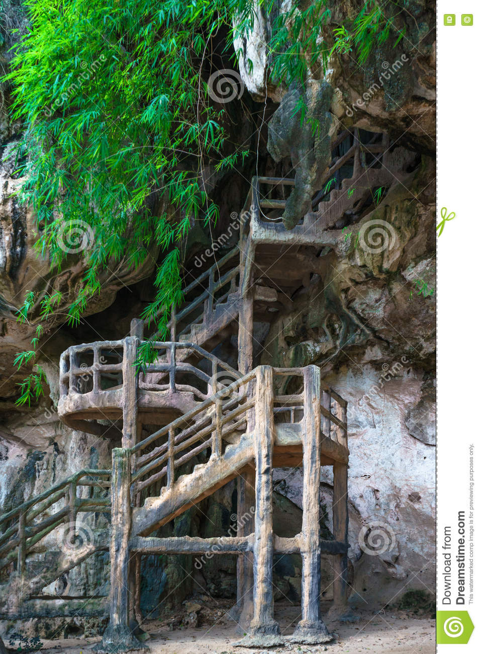 Man made stairs into cave on rocky cliff