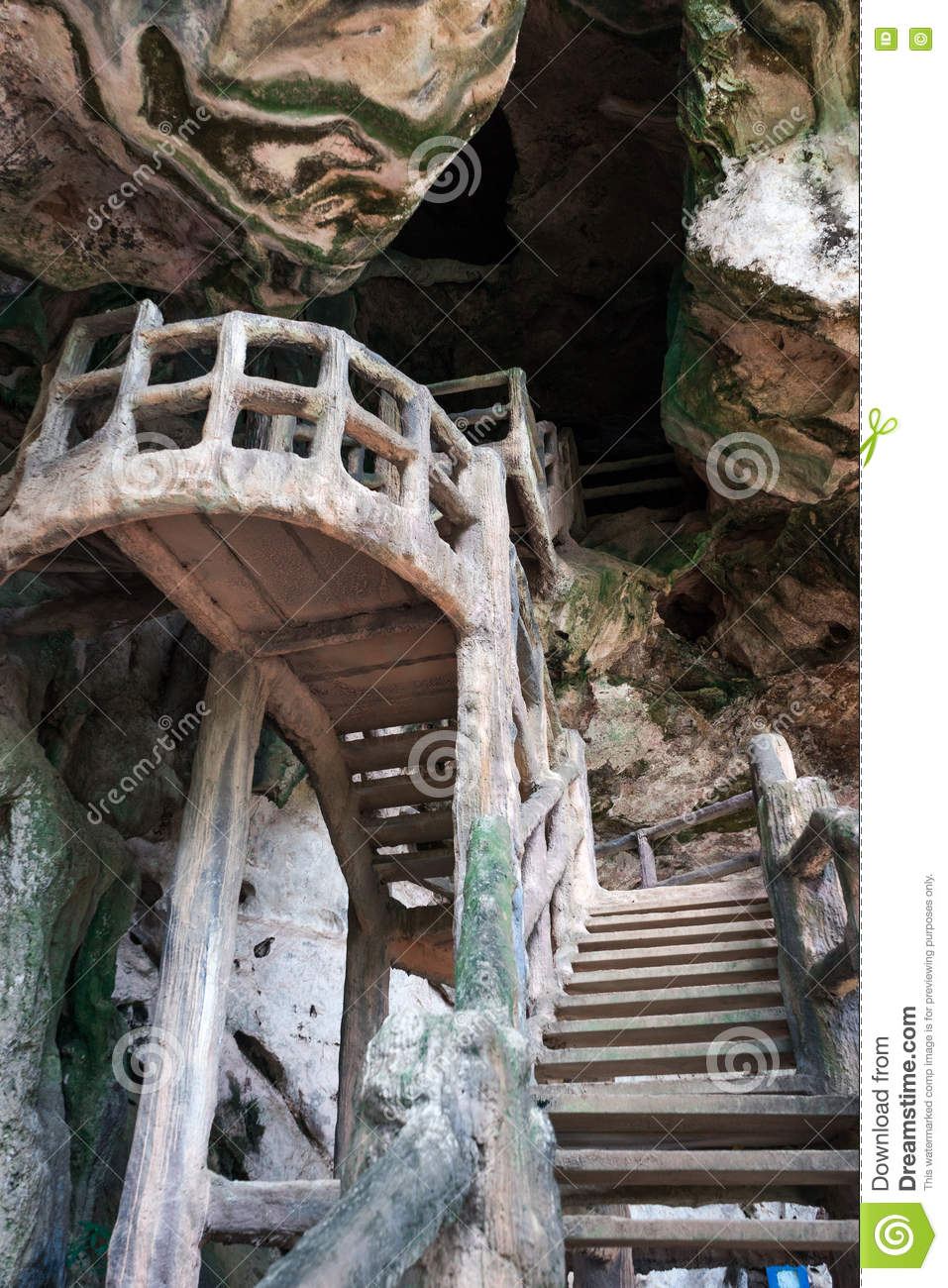 Man made stairs into dark cave