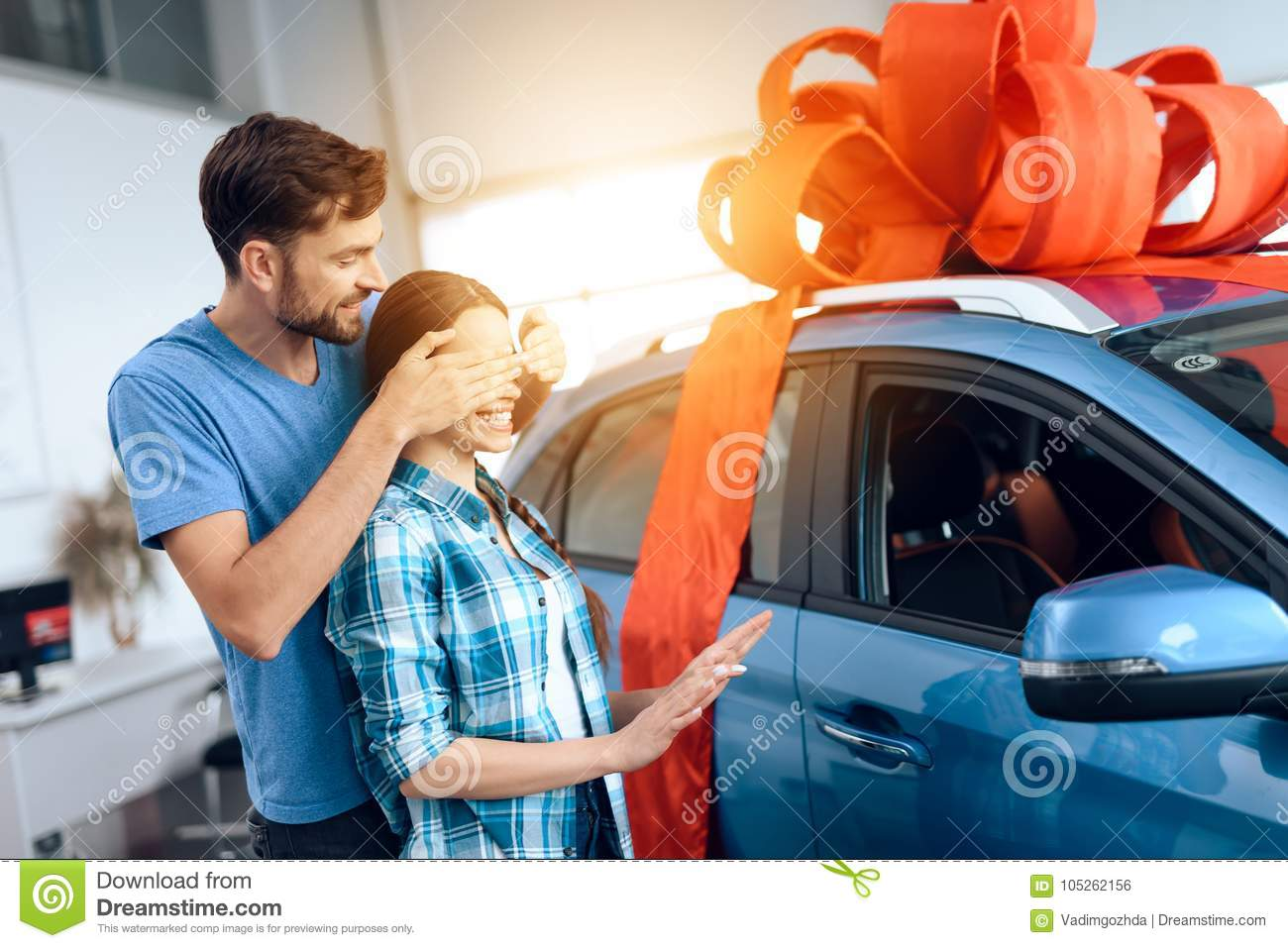A man makes a gift - a car to his wife.