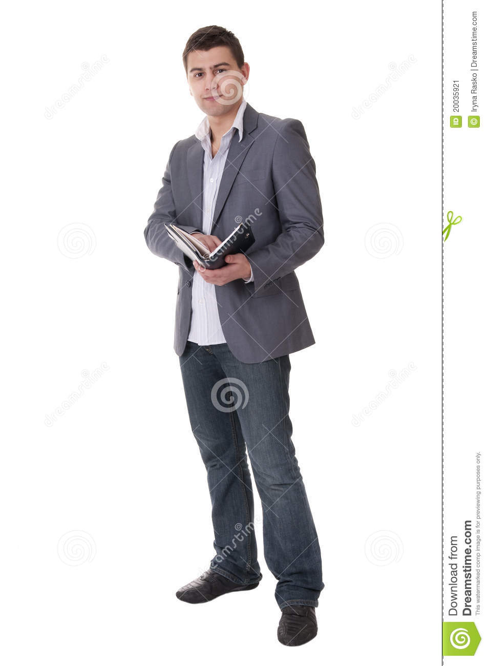 Man makes a note in notebook.