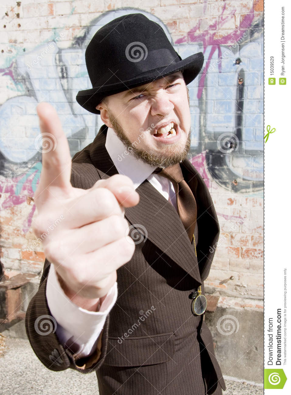 Vintage man makes an angry point while pointing with one finger