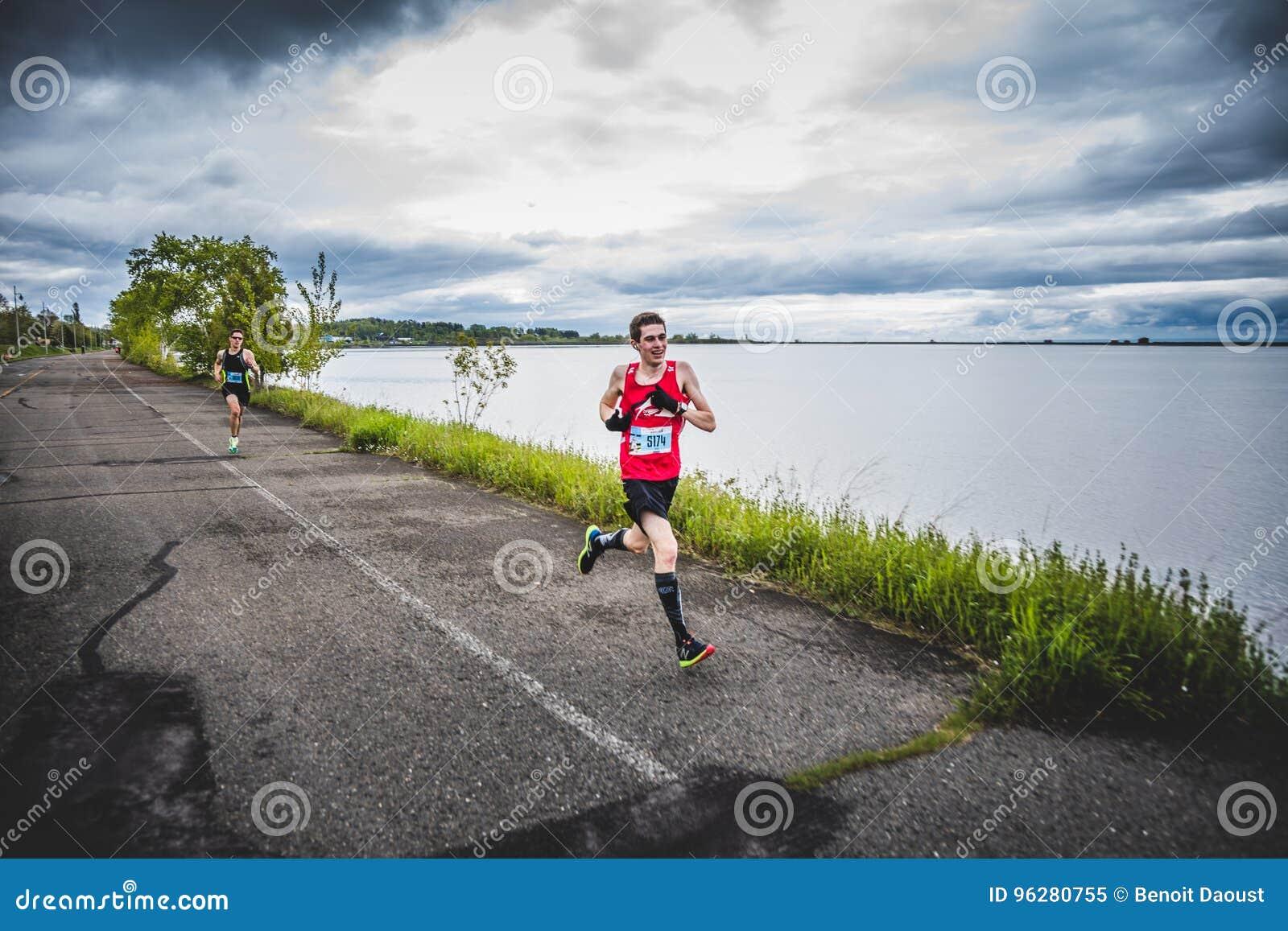 Man Marathoner Sprinting the last 500m before the Finish Line