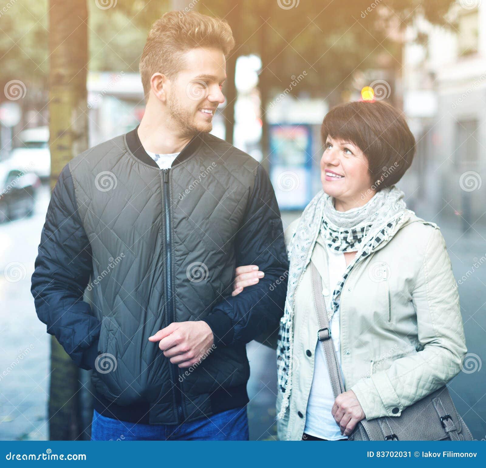 Man And Mature Woman Walking Stock Photo