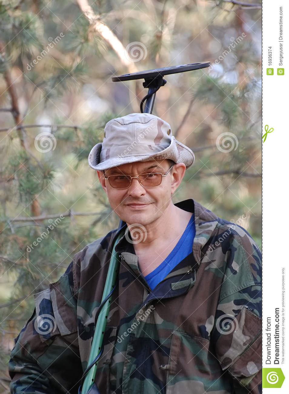 Man With Metal Detector Stock Images