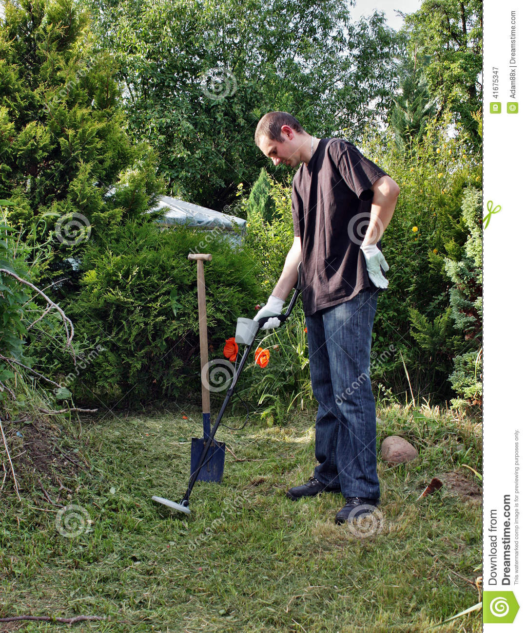 Jew Detector: Man With Metal Detector Stock Photo