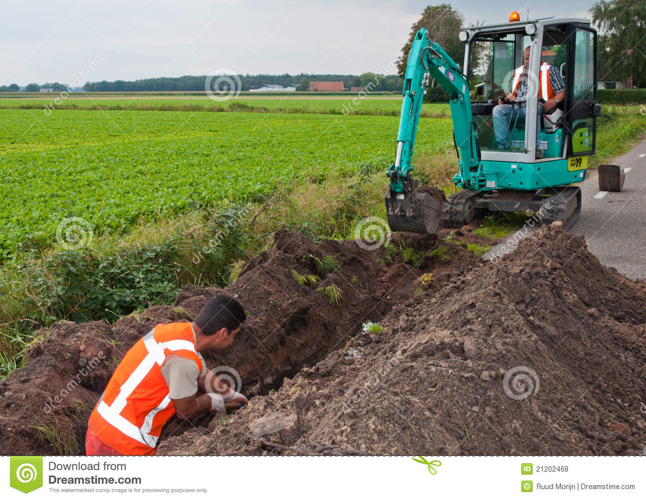 Man And Mini Excavator Dig A Trench To Lay Cables Editorial Stock