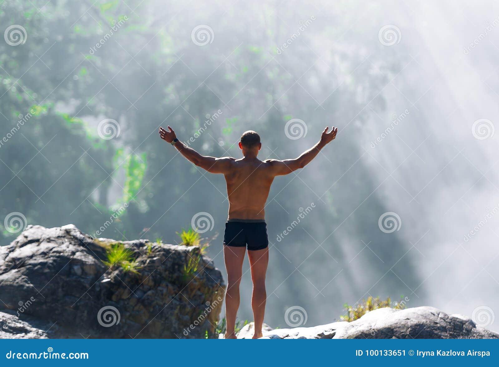 Man on mountain in Vietnam. Sunrise. Emotional scene.