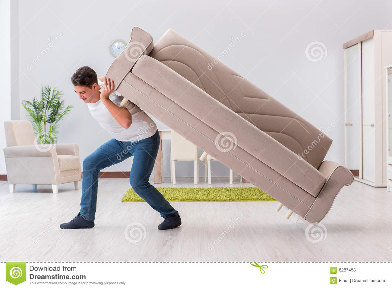 The Man Moving Furniture At Home Stock Photo Image - Moving furniture