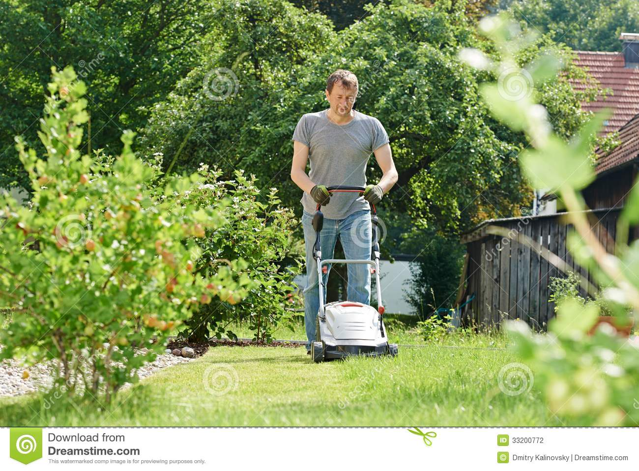 man mowing lawn backyard cutting grass his garden yard mower 33200772