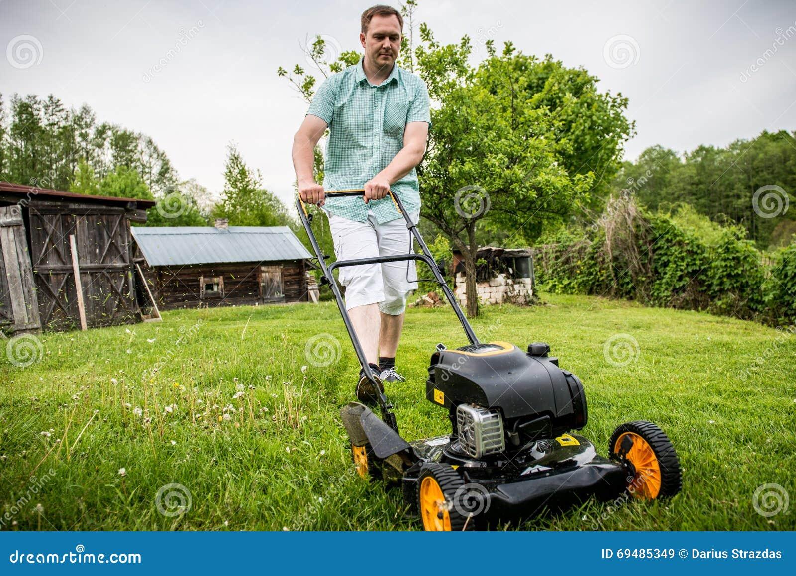 Man mowing lawn stock photo. Image of work, yard, garden