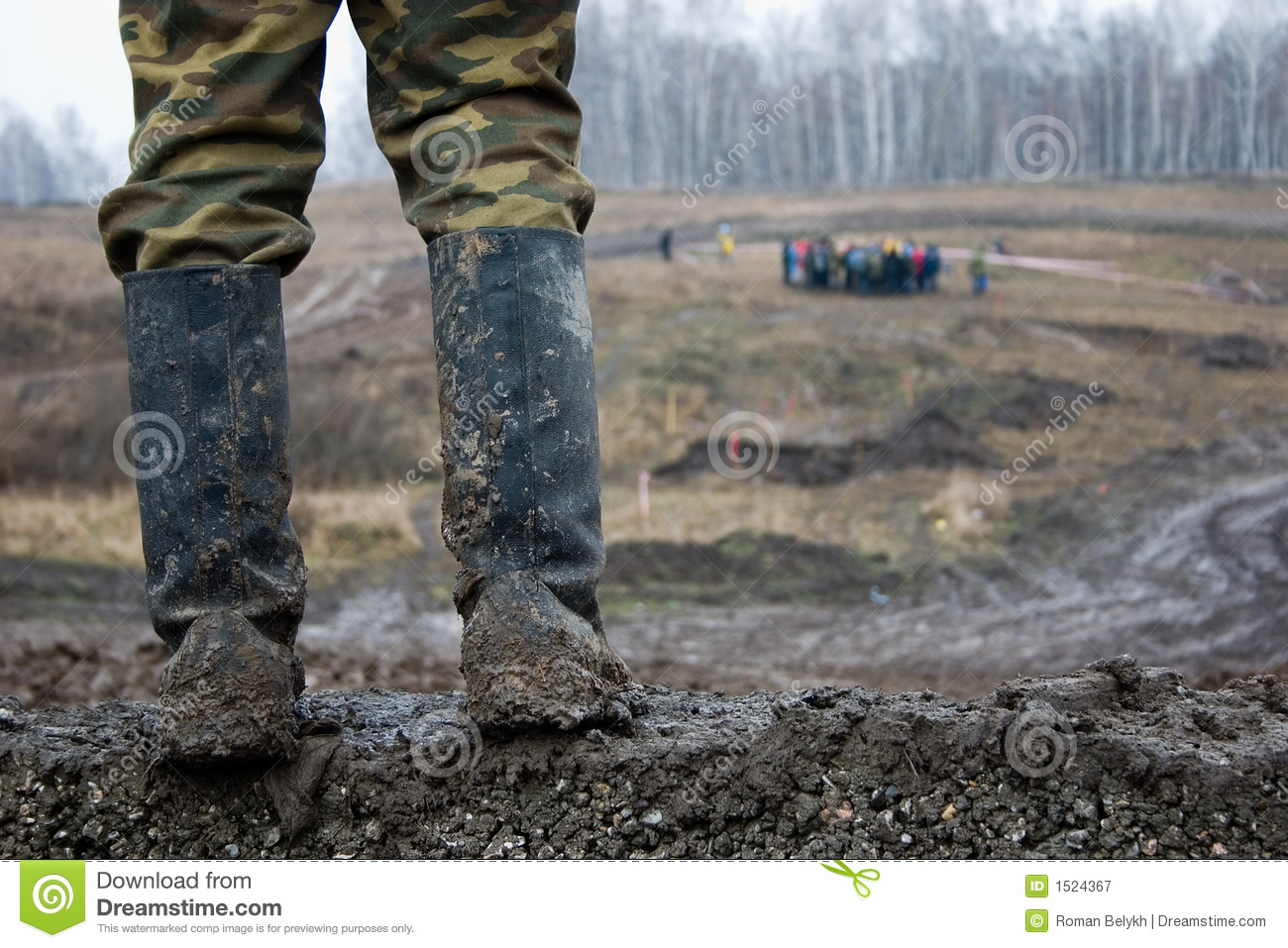 The Man In Muddy Kersey Boots Royalty Free Stock