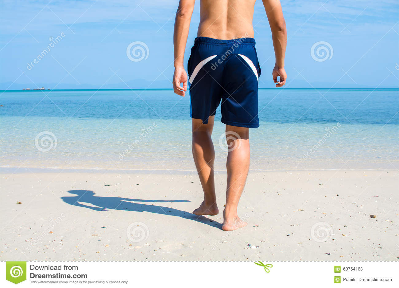 Man with no shirt walking barefoot