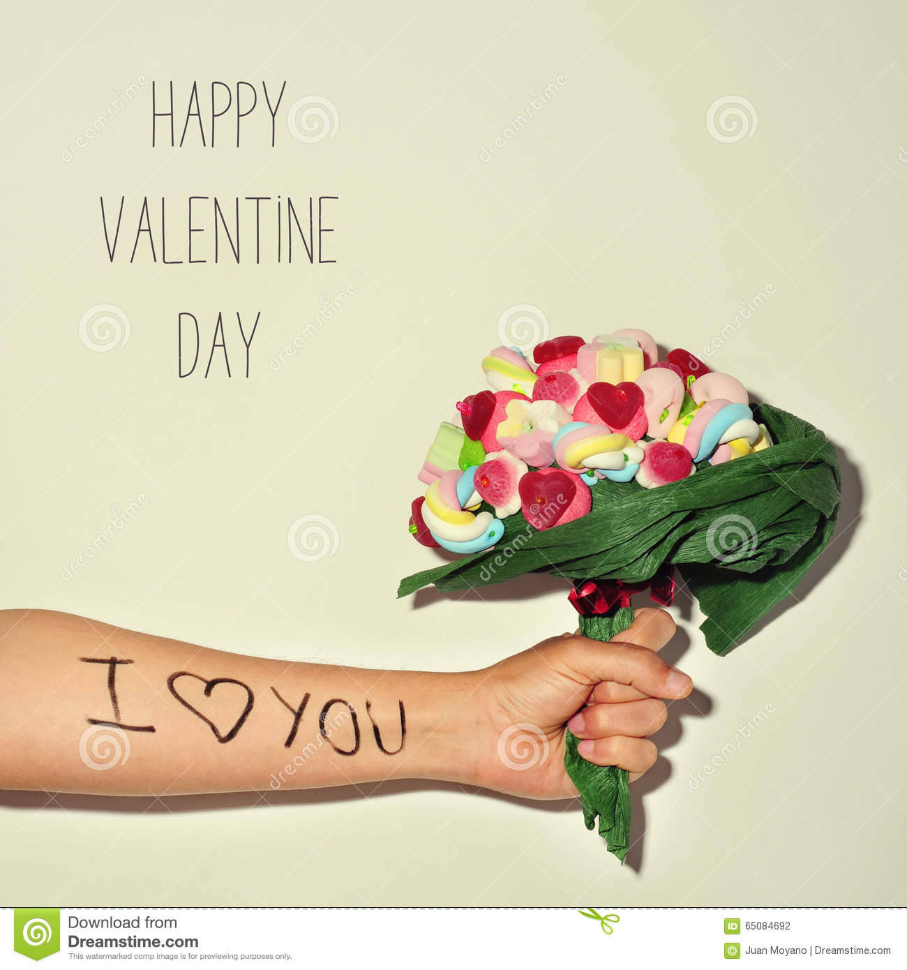 Man Offering A Candy Bouquet And Text Happy Valentines Day Stock
