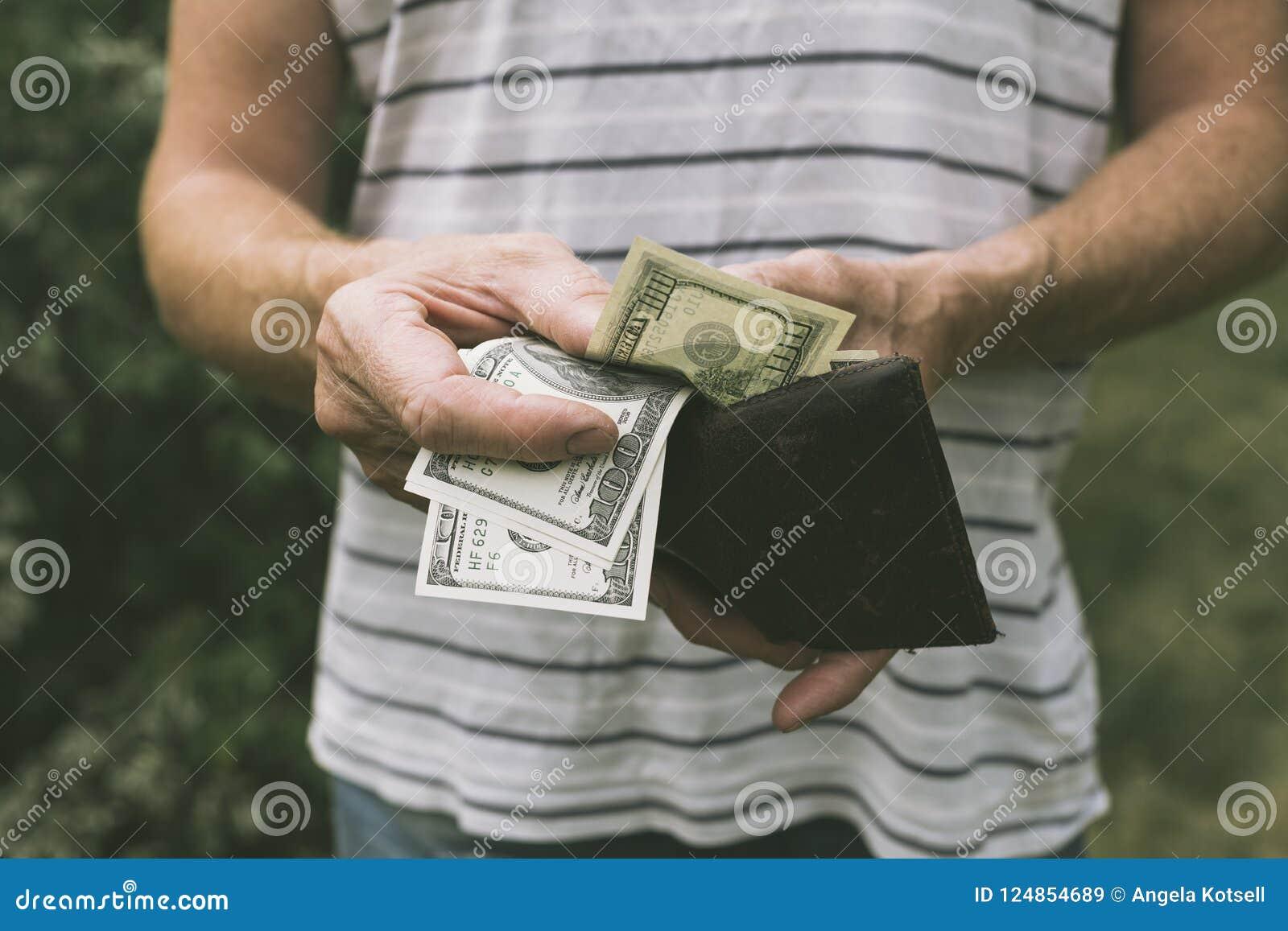 A man offering us dollars