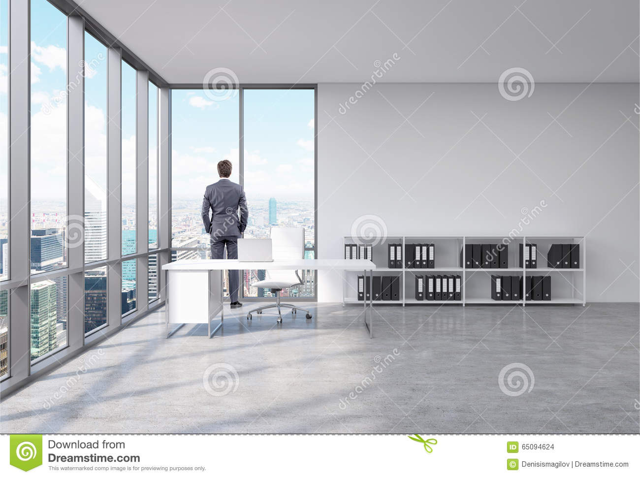 Man In An Office Front Of The Window