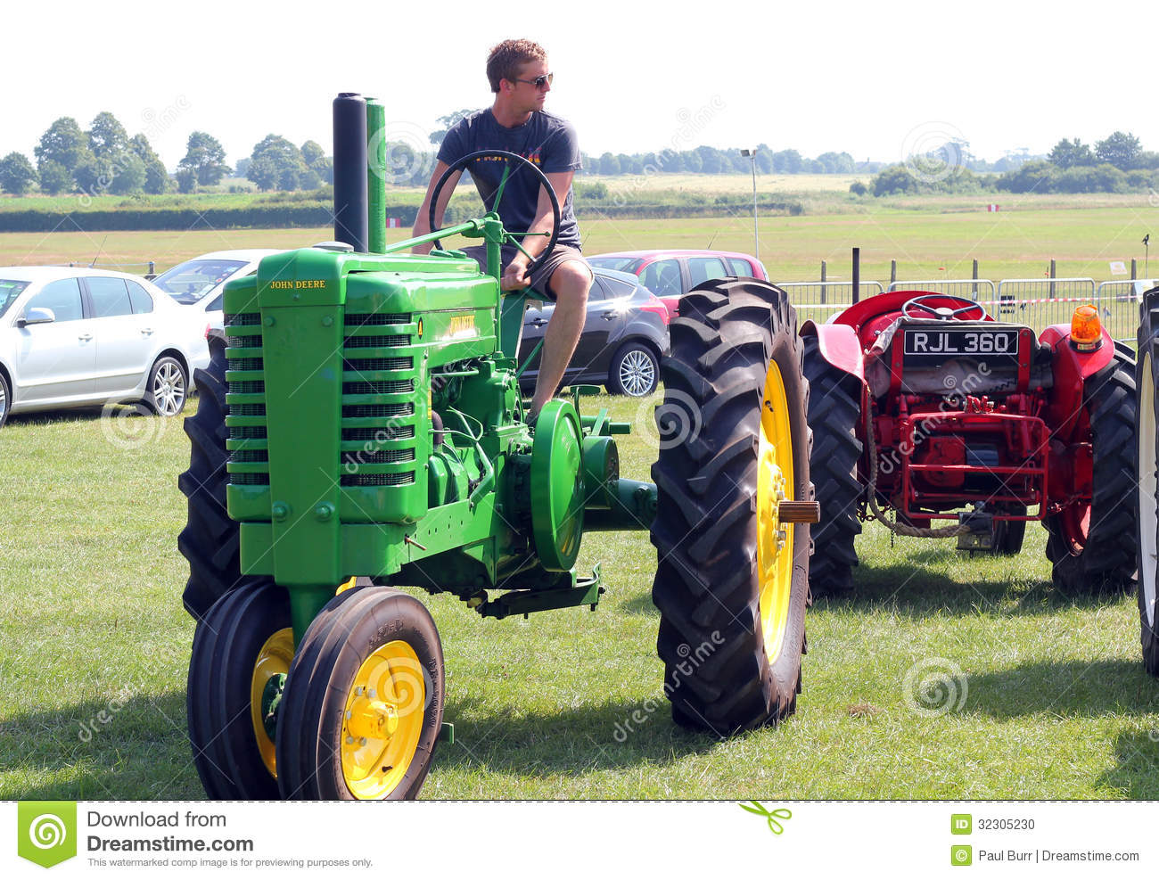 Guy On Tractor : Man on an old tractor editorial image