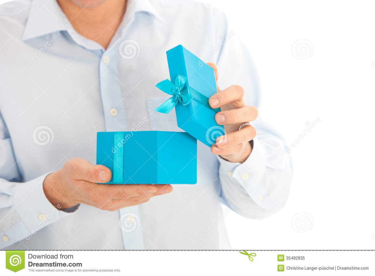 Man opening a birthday or Christmas gift