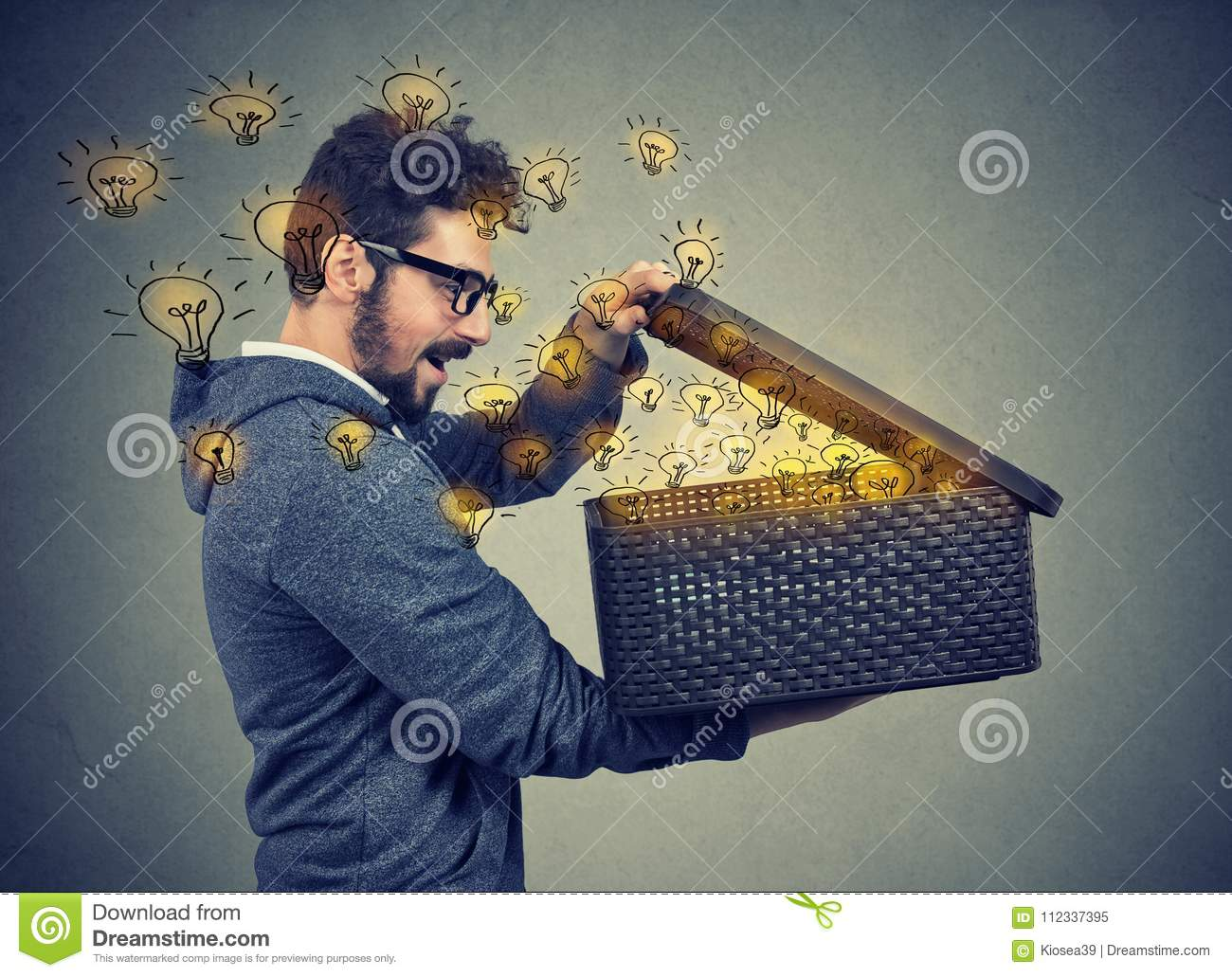 Man opening a box with many bright light bulbs