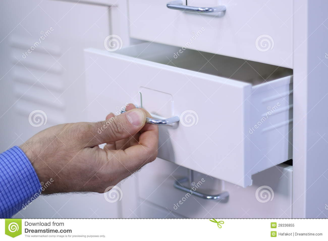 Office Furniture Blogs Man Opening A Drawer In A Cabinet Royalty Free Stock Photo