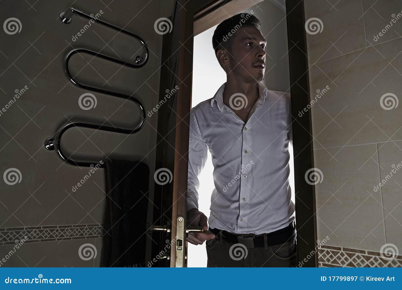 Man opens door to bathroom & Man opens door to bathroom stock image. Image of open - 17799897
