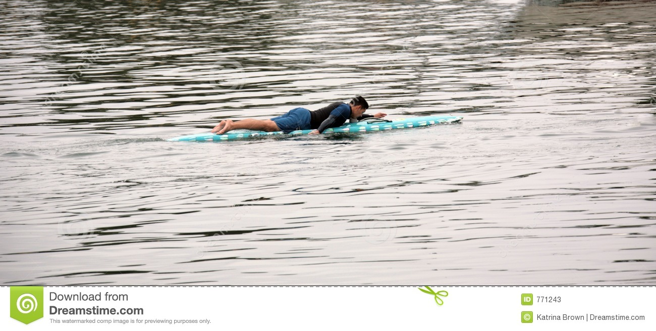 Man Paddling out to Surf