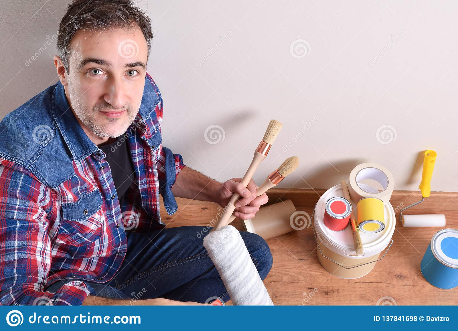 Man with paint tools on hands top elevated view
