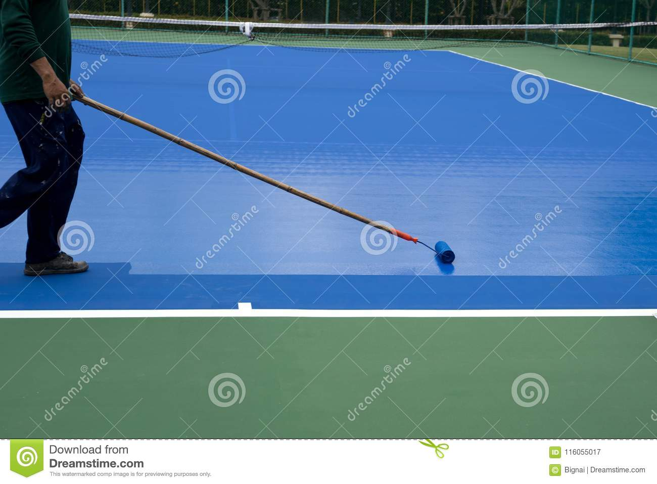 Man Painter Use Paint Roller Painting Tennis Court Stock Image