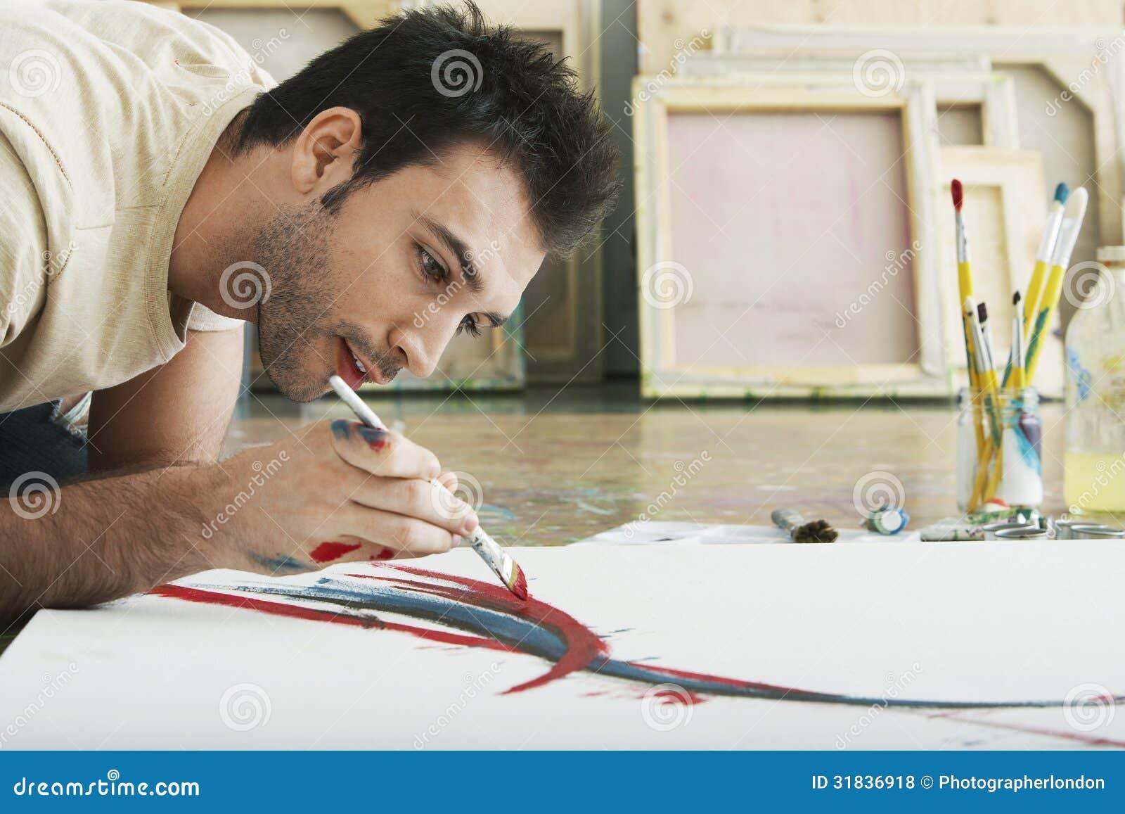 Man Painting On Canvas On Studio Floor Stock Photo Image