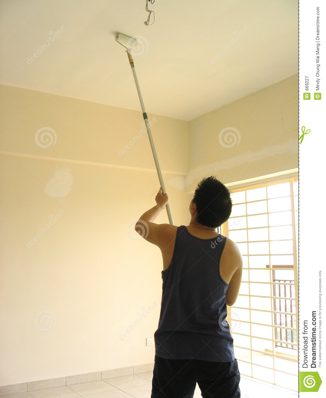 Smiling Handsome Man Painting Interior Wall Of Home. Stock Photo ...