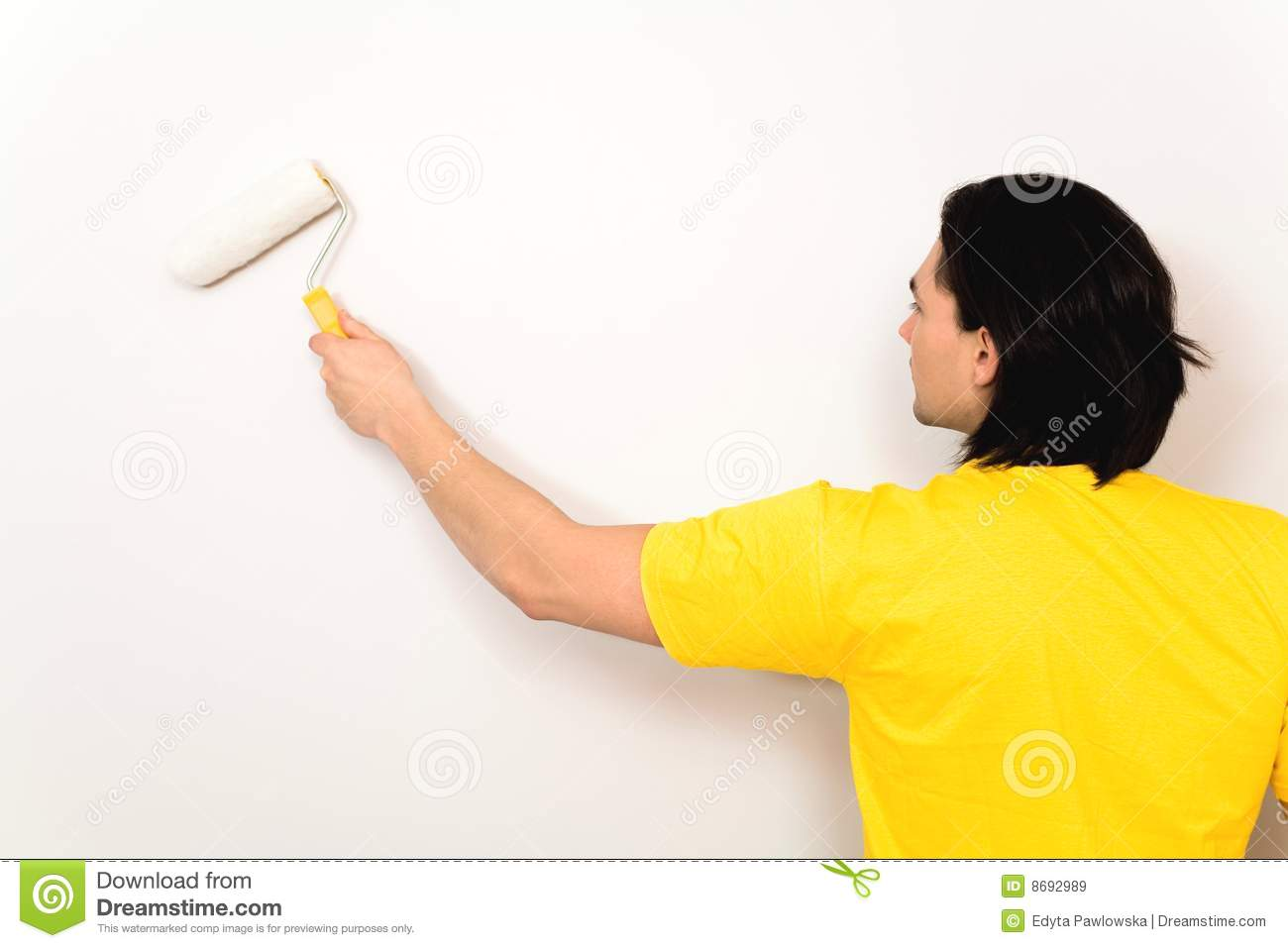 Man painting wall stock image. Image of indoors, young - 8692989